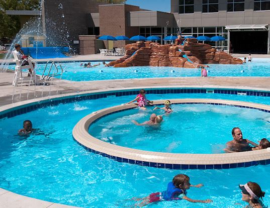 Group of people having fun at a aquatic center pool